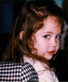 Miley Cyrus  --  look at those eyes and her cute little nose.  she hasn't changed much