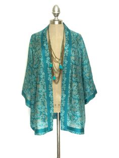 A pure silk kimono, in teal green  Beautifully made to designer standards, with french seaming throughout. I love its versatility, that in time will become a timeless addition to your wardrobe which you can pull out year after year...   Made from Pure up-cycled vintage Indian Silk, and each silk quality varies, eg crepe, satin, habotai etc, they are unique pieces, no two ever the same.  I can only ever make one kimono in each piece of vintage silk, so you are buying a truly one of a kind…