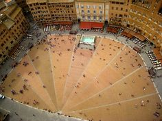 Piazza del Campo, Siena, Italy. The view from the tower was amazing! You could see my apartment from it, my roommate and I would take turns being on the tower and waving our the window! Hahah