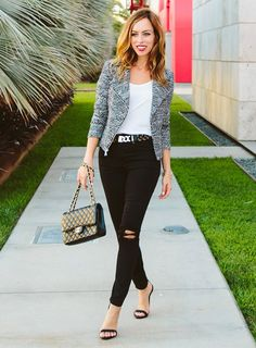 Sydne Style wears the ripped skinny jeans and heels fashion blogger trend
