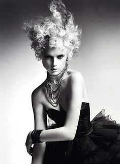 A long blonde curly quirky avant garde spikey hairstyle by Errol Douglas