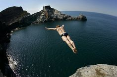 """Portovenere, Italy """"The top gets higher, the more that I climb."""" Reach for new heights, the higher you go the wider your vision grows. Places Around The World, Around The Worlds, Diving World, Diving Springboard, Cliff Diving, Live In The Now, Hawaii, The Incredibles, Italy"""
