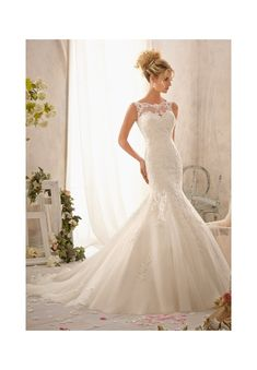 Wedding Dresses and Wedding Gowns by Morilee featuring 2610 Delicately Embroidered Lace Appliques on Net Delicate embroidered lace brings this romantic sheath to life. Accented with an illusion neckline and deep V back, this gown evokes a timeless bridal look that is traditional and chic. Colors Available: White, Ivory, Cream. Sizes Available: 2-28.