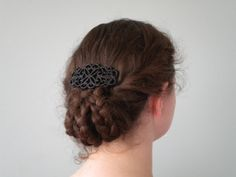 Hairstyle - three braids tucked into a flip and covered with a clip - Victorian, but could do for everyday?