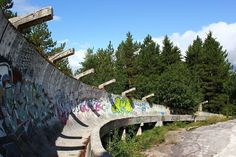 Once a proud feature of Sarajevo's 1984 Winter Olympic games, the bobsleigh track has since fallen into ruin after being the victim of military actions. When the Yugoslav Wars began in 1991, the 1300-meter track, like the rest of the country, became embroiled in the fighting. The curled turns were used as defensive positions for Bosnian forces, and the whole of the track became pocked with bullet holes and other wounds.