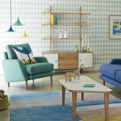 Sidde Armchair. Inspired by Heal's Scandinavian furniture of the 1950's Sidde has been reinvented by John Jenkins. Sidde features front legs that are longer than the back, to create a sloping 1950's aesthetic. Exclusive at Heals.co.uk