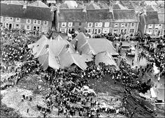 The Aberfan disaster was a catastrophic collapse of a colliery spoil tip in the Welsh village of Aberfan, near Merthyr Tydfil, on 21 October 1966, killing 116 children in the school and 28 adults. It was caused by a build-up of water in the accumulated rock and shale, which suddenly started to slide downhill in the form of slurry