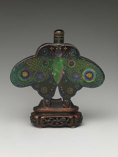 Snuff Bottle- Date: 19th century Culture: China Medium: Metal covered with lacquer and inlaid with mother-of-pearl and gold, wood stand