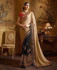 Black and beige georgette half and half sari. This sari is beautified with heavy floral embroidery and embroidered lace border work. It comes with a matching embroidered unstitched blouse.