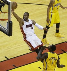 Dwyane Wade lays it up past Lance Stephenson during the first half of Game 7 in their 2013 NBA basketball Eastern Conference finals