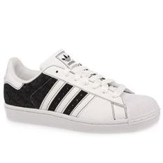 Adidas Male Superstar Ii Bsc Leather Upper in White and Black ADIDAS Superstar Ii Bsc The Superstar trainer was first introduced in 1969 as a low cut basketball shoe. Today it is still going strong for the more casual wearer and this variation has colourful stri http://www.comparestoreprices.co.uk/trainers/adidas-male-superstar-ii-bsc-leather-upper-in-white-and-black.asp