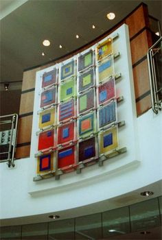 Wall art. Squares of fused glass put into a metal framing structure