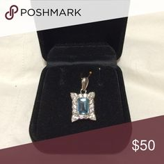 Aquamarine/CZ in 925 SS Emerald cut aquamarine framed by CZ round stones along the sides and 4 tear drop corner stones, set in S925 stamped silver, makes this pendant the perfect addiction to anyone's collection. Jewelry Necklaces