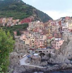 """Manarola, Italy is one of five tiny towns in a section of the Italian Riviera known as Cinque Terre. Although Cinque Terre translates to """"five..."""