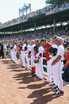 BOSTON, MA - APRIL 16: Manager Bobby Valentine of the Boston Red Sox lines up with his players for the national anthem bfore the game against the Tampa Bay Rays on April 16, 2012 at Fenway Park in Boston, Massachusetts. The Tampa Bay Rays defeated the Boston Red Sox 1-0. (Photo by Elsa/Getty Images)
