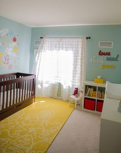 Aqua, yellow, and red nursery - cute rug and yellow lamp -- from ontobaby.com