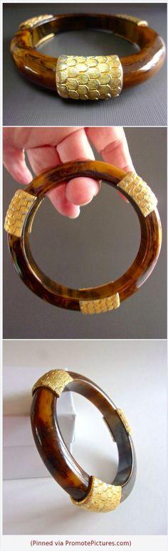 BAKELITE Tortoise Swirl Caramel Bangle, Gold Appliques, Vintage #bangle #bracelet #bakelite #caramel #swirl #brown #appliques #gold #vintage #tortoise https://www.etsy.com/RenaissanceFair/listing/582380679/bakelite-tortoise-swirl-caramel-bangle?ref=listings_manager_grid  (Pinned using https://PromotePictures.com)