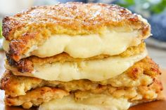 """Cauliflower Crusted Grilled Cheese Sandwiches recipe: Make your """"bread"""" out of cauliflower! This tasty version of a grilled cheese is gluten-free and lower in carbs. Just look at all of that melty cheese action. Recipe Using Cauliflower, Cauliflower Recipes, Ketogenic Recipes, Low Carb Recipes, Healthy Recipes, Low Carb Lunch, Low Carb Keto, Keto Snacks, Food Processor Recipes"""