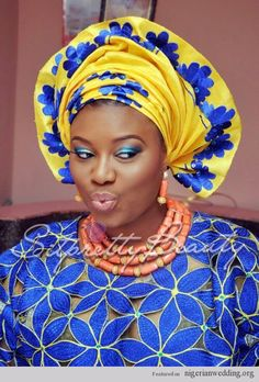 Nigerian Wedding Blue Iro and Buba lace and Yellow and blue Aso Oke head tie with orange coral beads