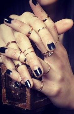 I love this look - gold band knuckle rings and creative black nails