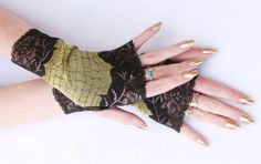 Metallic gold and black lace fingerless gloves by Steampunkwolf, $28.00 Steampunk Belle, Belle Costume, Metallic Gold, Fingerless Gloves, Arm Warmers, Costumes, Trending Outfits, Unique Jewelry, Lace