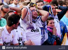 real-madrid-supporters-react-while-watching-the-uefa-champions-league-FW31XW.jpg (1300×956)