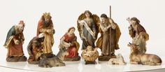 "4.5"" Heaven's Majesty Nativity Figure Set   Wood carved look, hand-painted in traditional colors. Beautiful 11 piece heirloom quality nativity set. Removable Baby Jesus! This stunning Nativity has some of the finest detail we've seen! The faces on these figures are painted with great care and the quality is visible. Figures are 4.5"" tall. (Item #23590)"