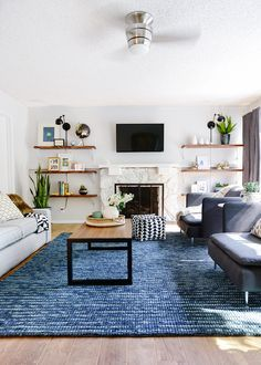 Check out this living room transformation by Yellow Brick Home. Updated paint and furniture make a big impact in this space.