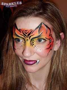 Tiger mask face painting. Perfect for adults & older children/teens.