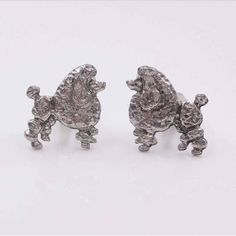 Check out this item in my Etsy shop https://www.etsy.com/listing/521087213/standard-poodle-cufflinks-silver-tone