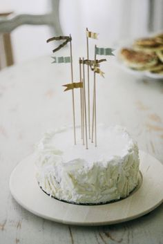 "Cake: A simple homemade cake was styled up using DIY flags. ""I loved the banners and the little handmade cake flags"