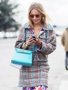 A Chanel tweed jacket is paired with a tweed skirt, printed skirt, and an Hermes top-handle bag