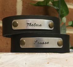 Thelma and Louise Leather Cuffs SET OF TWO Hand-stamped Wrap & Snap Cuff Bracelets by BlueWillowBracelets on Etsy https://www.etsy.com/listing/499365531/thelma-and-louise-leather-cuffs-set-of