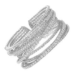 Large Diamond Cuff .Large diamond strands flowing in different directions. An amazing piece with beautiful and intricate design. The bracelet is about 2 inches wide and has an immense amount of depth to it. Set with over 20 carats of top quality diamonds.