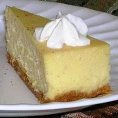 Eggnog Cheesecake ~ This is a delicious cheesecake for eggnog lovers. The secret to a smooth cheesecake is to cream the cream cheese in a food processor for several minutes,,