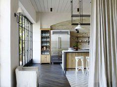 Doors, linen drapes, refrigerator, shelving to left of fridge. Harbour Front Residence by Hess | Hoen