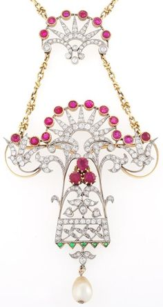Art Nouveau gold, diamond, ruby, emerald, and pearl pendant necklace. With 140 old European-cut diamonds with an approximate total weight of 4.10 carats, 25 round-cut rubies with an approximate total weight of 4.15 carats, 5 round-cut emeralds with an approximate total weight of .10 carats, it has some lovely sparkle and color. The pendant culminates in a pearl drop. The larger pendant detaches and can be worn as a brooch.