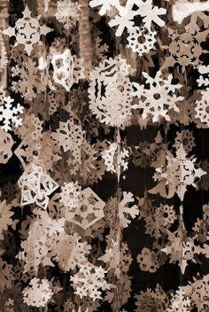 Paper snowflake garland window display by jasmine.