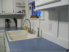 Board and Batten backsplash - I desperately want to do this in our kitchen.