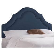 Arched pine wood headboard with foam cushioning and trim detail. Handmade in the USA.   Product: HeadboardConstruction Ma...