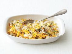 Hot Tips From Food Network Kitchens' Katherine Alford:    Leftover rice comes in handy when you're throwing together a quick dish, like Food Network Magazine's Corn Fried Rice, or when you need to bulk up a stir-fry or soup. Cook a big batch, cool it, then freeze it in a microwave-safe storage container for up to 1 month. To thaw, sprinkle the rice with water and microwave, covered, until heated through.