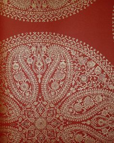 Paisley Circles Wallpaper Large paisley design wallpaper in gold on red.