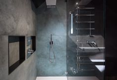 Dark polished plaster bathroom with turquoise large format porcelain tile. shower niches with chrome handheld shower and rain shower head above Architects London, Polished Plaster, Earls Court, Residential Architect, Shower Niche, Hand Held Shower, Rain Shower, Large Format, Porcelain Tile