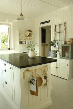 White Kitchen like utensil bar and hooks on island. Would work with side cabinet and ikea stuff bar...