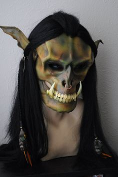 Leather Orc Mask. full face with synthetic Hair. Handmade by Parkers and Quinn.green/brown mottled. Beads wood leather feathers,metal.