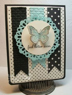 handmade greeting card from It's a Stamp Thing ... black and white with a pop of Pool Party (aqua) ... like the design ... fish tail banners on a polka dot panel ... medallion with die cut lace edging ... stamped, cut out and popped up butterfly tops it off ... great card!! ... Stampin' Up!