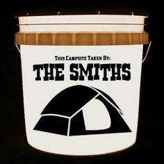 This bucket light is personalized with This Campsite Taken By and your family name, along with a tent.