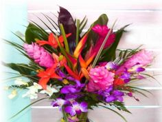 I want a tropical themed wedding...bringing the tropics to minnesota!  Love these flowers!!!