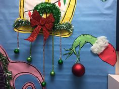 The Grinch Who Stole Christmas party decorations for teachers lounge. Whoville house out of butcher paper.