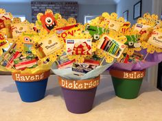 """Teacher appreciation week gift card bouquet. Cupcake liner flowers, terra cotta pots, gift cards, coupons and flower seed packets. """"Thanks for helping us grow!"""""""